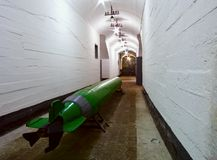 Torpedo in the military dock base submarine silo. Torpedo in the military dock, silo Royalty Free Stock Photography