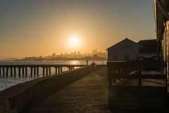 Torpedo Wharf and downtown silhouette at sunrise in San Francisco royalty free stock photography