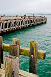 Torpedo Wharf, Fishing on the pier on a cloudy day Royalty Free Stock Images