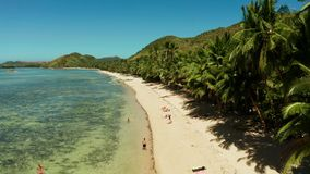 Torpical island with white sandy beach, top view. stock footage