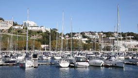 Torquay Devon UK harbour with yachts and boats on beautiful day pan stock video