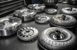 Torque Converter Break Down. A view of torque conveters taken apart into pieces and laid out on a metal table Royalty Free Stock Photography