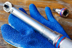 Torque wrench and work glove on the table in workshop Royalty Free Stock Image