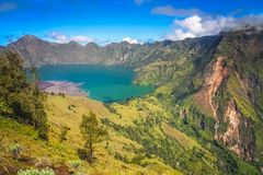 Gunung Rinjani caldera lake from above. Torquise lake inside the caldera of Gunung Rinjani volcano in Lombok island, Indonesia royalty free stock images