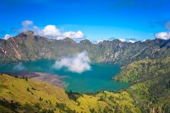 Gunung Rinjani caldera lake from above. Torquise lake inside the caldera of Gunung Rinjani volcano in Lombok island, Indonesia stock photos