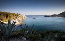 Torquois hidden bay in Rhodes Greece Royalty Free Stock Images