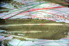 Torr gyttja på färgrika linjer, abstrakt bakgrund Fotografering för Bildbyråer