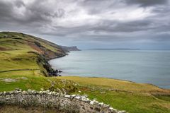 Torr Head Coastline. This is a picture of the coastline looking back to Fair Head cliffs from Torr Head on the Antrim Coast in Ireland stock photo