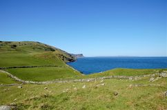 Torr Head. View over the headland Torr Head with its rugged coast over the Mull of Kintyre in the County Antrim in Northern Ireland, UK stock photos