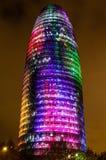 Torre Agbar con las luces de la Navidad Foto de archivo libre de regalías