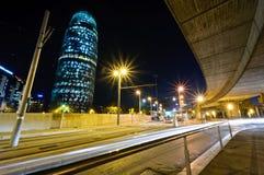 Torre Agbar night view. Torre Agbar night view with traffic and car lights. Barcelona, Spain Stock Photos