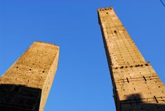 Torre Asinelli and Garisenda in sun and blue skies in Bologna (Italy) Stock Images