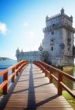 Torre of Belem, Lisbon, Portugal. Facade of Torre of Belem with bridge, famouse landmark of Lisbon, Portugal, retro toned royalty free stock photo