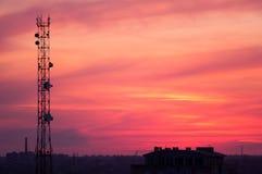 Torre celular en la puesta del sol Imágenes de archivo libres de regalías