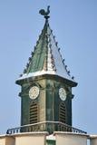 Torre com weathercock e neve Fotos de Stock