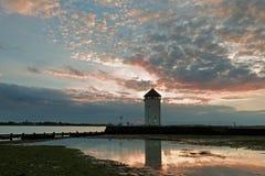 Torre costiera dell'allerta al tramonto Immagine Stock