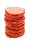 Torre das fatias de salami sobre o branco Fotos de Stock Royalty Free