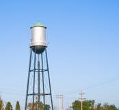 Torre de agua para una pequeña ciudad Imágenes de archivo libres de regalías