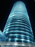 Torre de cristal en la noche Foto de archivo libre de regalías