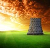 Torre de enfriamiento en la puesta del sol Imagen de archivo