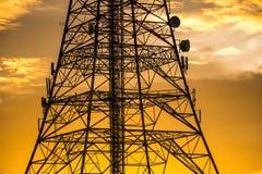 Torre de la señal en puesta del sol Imagen de archivo libre de regalías
