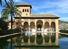 Torre de las Damas, Alhambra, Granada, Spain. Torre de las Damas and its reflection in a pool in the Alhambra of Granada, Spain royalty free stock images