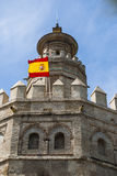 Torre De Oro in Sevilla with spanish flag Stock Image