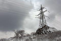 Torre de potência após a queda de neve Foto de Stock Royalty Free