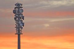 Torre de radio en la puesta del sol Fotografía de archivo