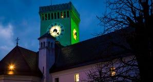Torre de reloj en la noche Ljubljana Fotos de archivo