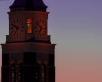 Torre de reloj en la salida del sol Foto de archivo