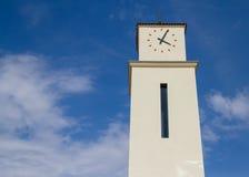 Torre de reloj española nea Imágenes de archivo libres de regalías