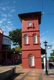 Torre de reloj roja en Malaca Fotografía de archivo libre de regalías