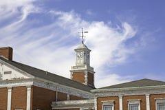 Torre de reloj vieja con la paleta de viento Fotos de archivo libres de regalías