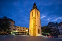 Torre de sino velha giessen Alemanha na noite fotos de stock royalty free