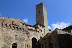 Torre dei Becci tower in San Gimignano, Italy. The torre dei Becci tower and the gate to the Piazza della Cisterna town square in San Gimignano, Italy Stock Photos