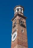 Torre dei Lamberti (Lamberti Tower). In the middle of Piazza Erbe, Verona ,Italy ,on the corner towards la Costa, stands the slim Tower of the City, or Lamberti Stock Photos
