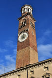 Torre dei Lamberti, the tallest tower and a landmark in the center of Verona. Tower of Lamberti, a beautiful medieval and renaissance tower with ancient clock in Stock Photos