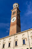 Torre dei Lamberti, Verona. Torre dei Lamberti in medieval center of Verona (Piazza Erbe), the highest tower in the city Stock Photos