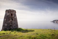 Old stone watchtower in almunecar spain royalty free stock photos
