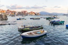 Torre del Greco, Naples, Italy - panoramic view from the port of blue sea, boats and city Royalty Free Stock Image