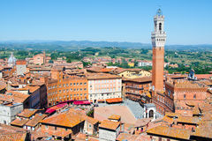 Torre del Mangia in ancient medieval historical centre of Siena Stock Images