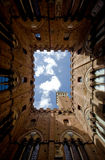 Torre del Mangia, Piazza del Campo, Siena, Italy. Torre del Mangia, in Siena, Tuscany (Italy), photographed from the courtyard of the palazzo Pubblico with Stock Photography