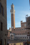 Torre del Mangia on Piazza del Campo. Siena, Tuscany, Italy. Stock Photo
