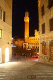 Torre del Mangia seen from an alley, Siena Royalty Free Stock Photography