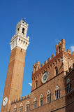 Torre del Mangia, Siena, Italy. The Torre del Mangia is a tower in Siena, in the Tuscany region of Italy. Built in 1325-1348, it is located in the Piazza del Royalty Free Stock Photo