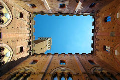 Torre del mangia siena is a tower in Siena, Italy Royalty Free Stock Photo