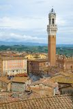 Torre del Mangia tower over the roofs of Siena, Italy Stock Image