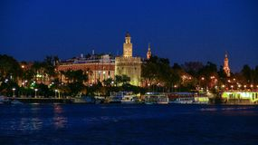View of Golden Tower Torre del Oro of Seville, Andalusia, Spain over river Guadalquivir. The Torre del Oro English: `Tower of Gold` is a dodecagonal military stock images