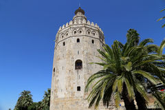 Torre del Oro or Golden Tower (13th century), a medieval Arabic military dodecagonal watchtower in Seville, Andalusia, Spain Stock Images